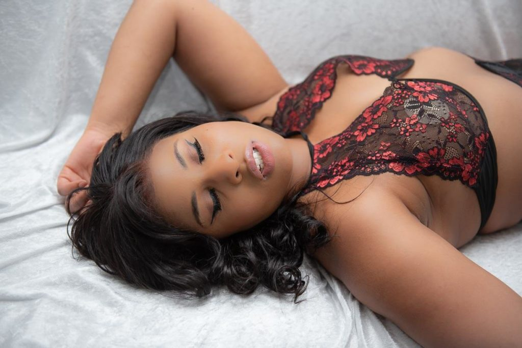 girl in red and black lingerie on white sofa