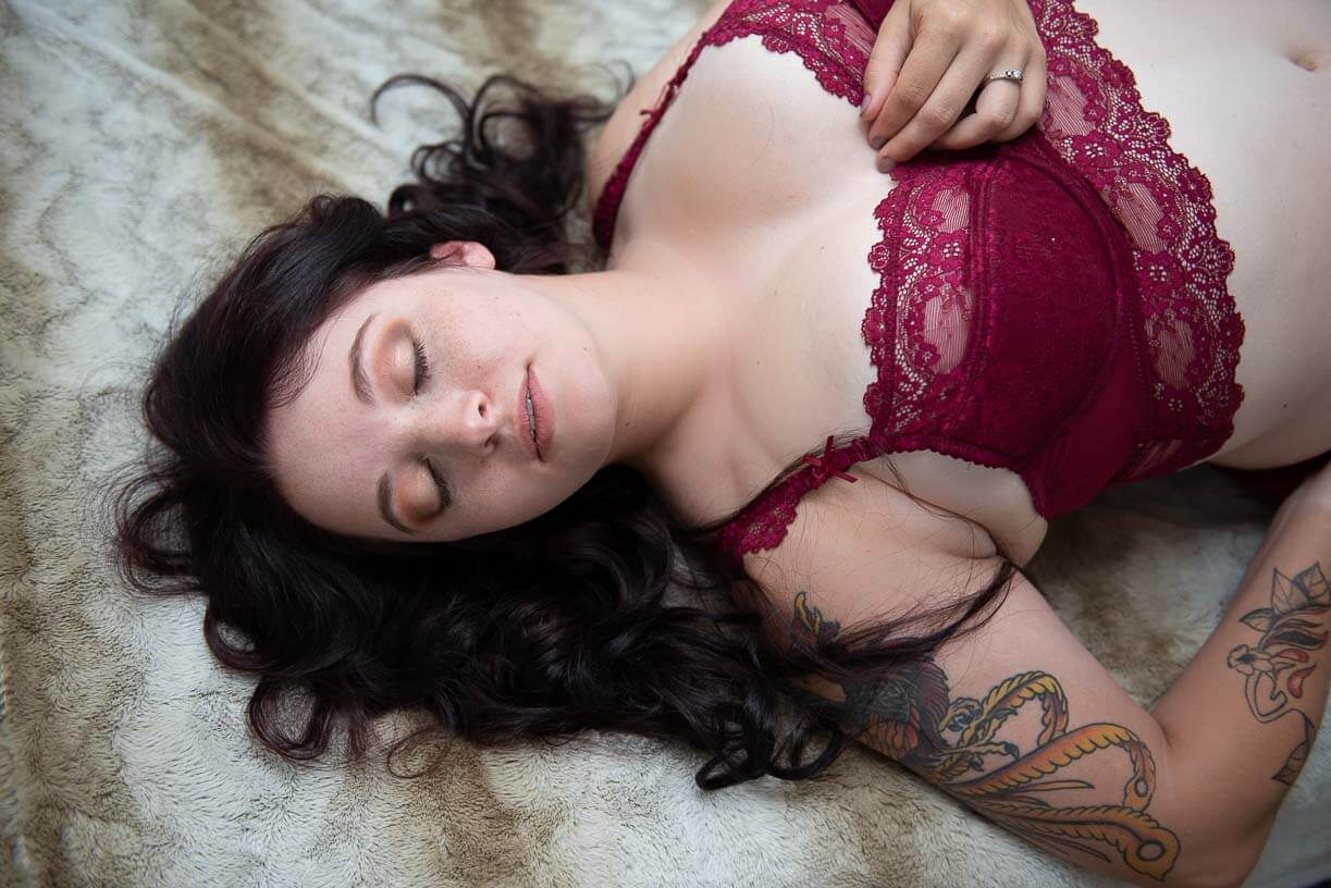 girl in red lingerie on beige rug